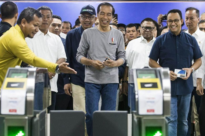 Indonesian President Joko Widodo (centre) checks the Mass Rapid Transit facilities with Jakarta's Governor Anies Baswedan (second from right) and ministers during the MRT inauguration ceremony in Jakarta, Indonesia, on March 24, 2019.