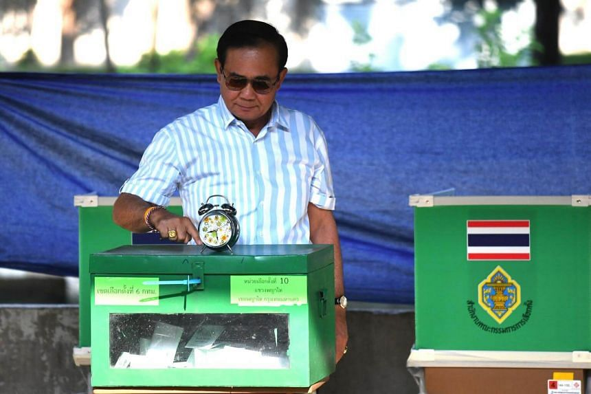 Thailand's Prime Minister Prayut Chan-o-Cha casts his ballot at a polling station in Bangkok, on March 24, 2019.