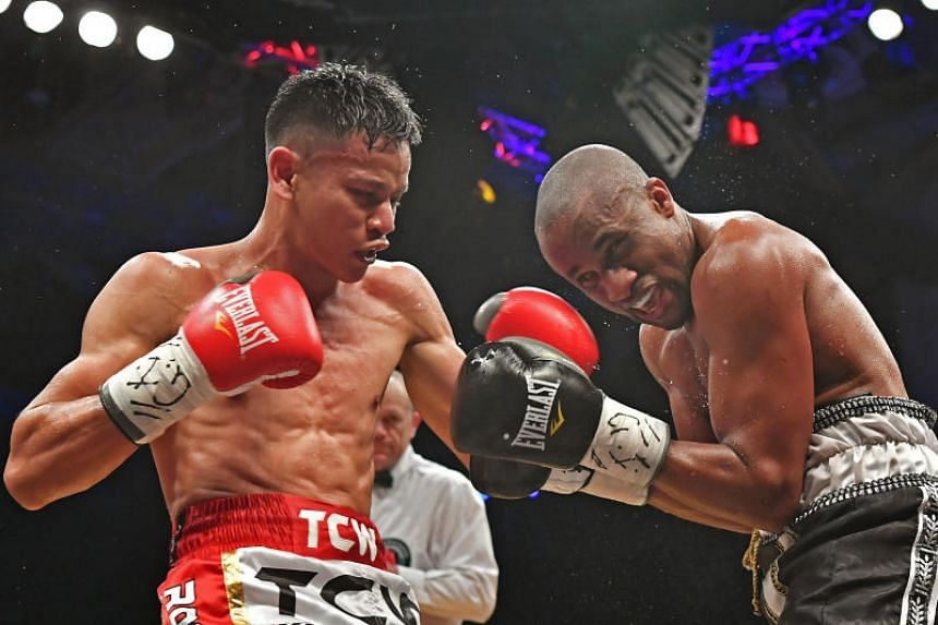 Top pro boxer Muhamad Ridhwan (left) said a commission would help ensure fighters' rights and safety are protected.