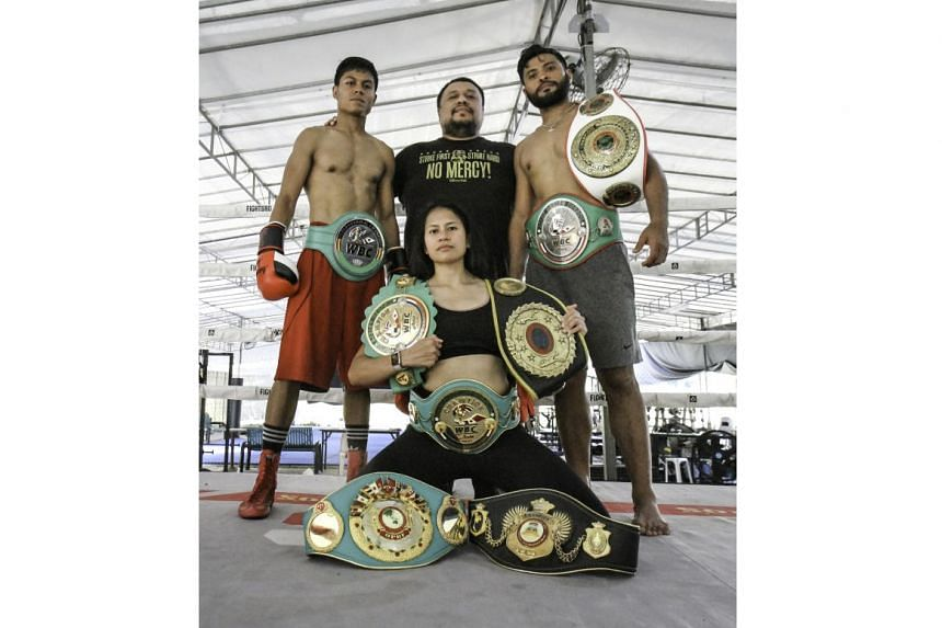 Singaporean boxing promoter Arvind Lalwani (centre) with the professional boxers under his charge (from left) Muhammad Ashiq, Nurshahidah Roslie and Rafi Majid.