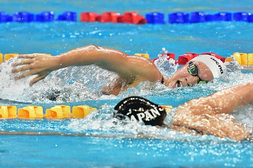 Gan Ching Hwee (in white cap) competing in the women's 1,500m freestyle on March 24, 2019. She set a new national record of 16:33.54.