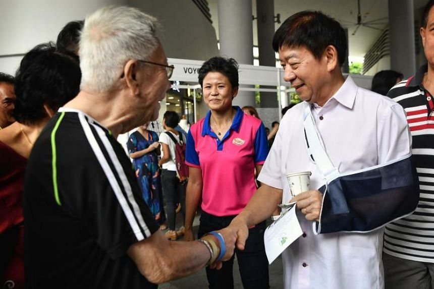 Transport Minister Khaw Boon Wan, accompanied by grassroots leader Poh Li San, at the Women's Festival at Kampung Admiralty on March 24, 2019.