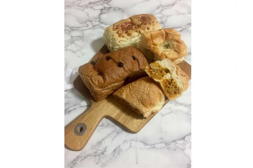 Thai Baang's loaves include (clockwise from far left) Thai milk tea chocolate; basil leaves and cheese; banana chocolate; and Tom Yam Chicken.