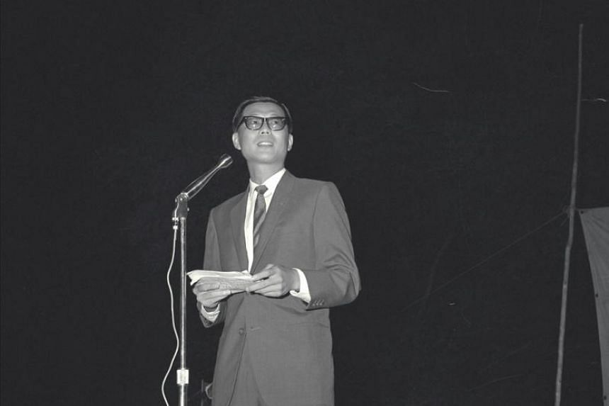 Mr Ong Pang Boon addressing diners at a dinner party for Yong Cheng Chinese School in Club Street, in June 1964.