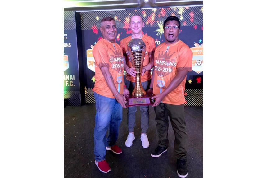 (From right) Chennai City coach Akbar Nawas, striker Jozef Kaplan and assistant coach K. Balagumaran celebrating with the I-League trophy.