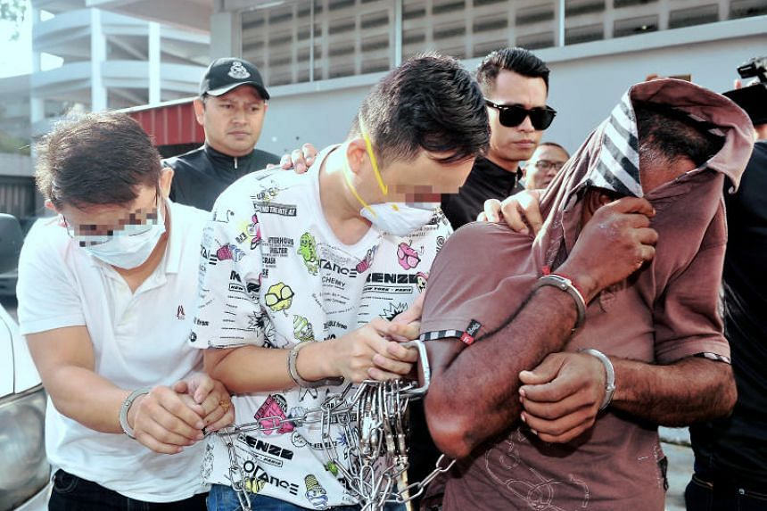 The three suspects in the case regarding the chemical spill at Sungai Kim Kim accompanied by police at the Johor Baru Sessions Court  to face criminal charges.