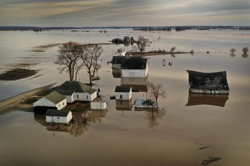 """Floodwater surrounds a farm near Craig, Missouri, on March 22, 2019. Midwest states are battling some of the worst floodings they have experienced in decades as rain and snowmelt from the recent """"bomb cyclone"""" has inundated rivers and streams."""