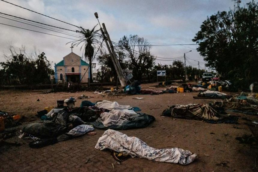 People displaced from their homes by cyclone Idai sleep on a street as they stay in a shelter in Buzi, Mozambique, on March 23, 2019.