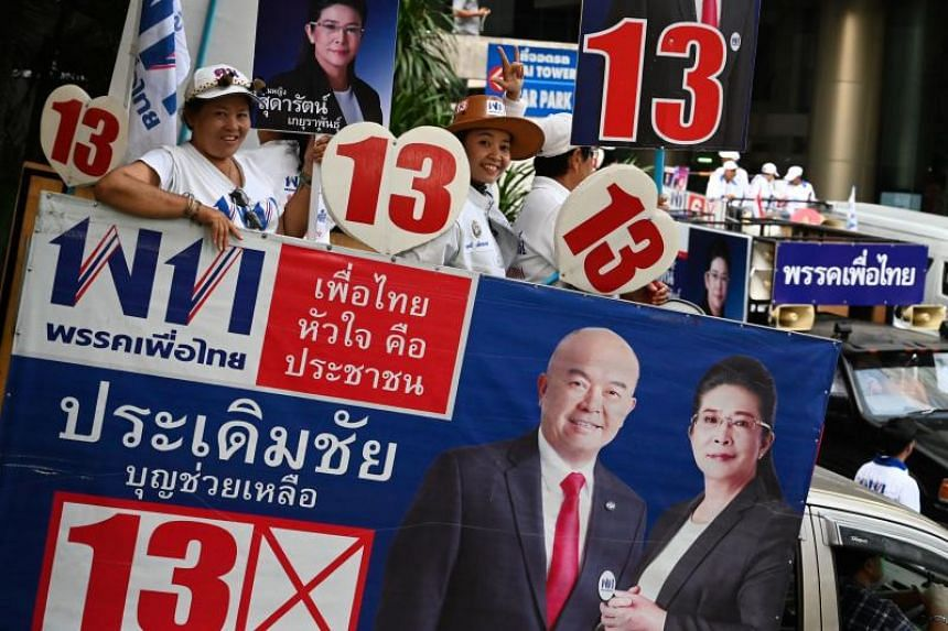 Pheu Thai party supporters campaigning in Bangkok on the eve of the general election, on March 23, 2019.