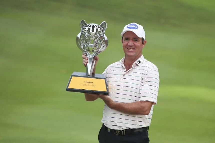 Australia's Scott Hend holds the trophy after winning the Malaysia Maybank Golf Championship in Kuala Lumpur on March 24, 2019.