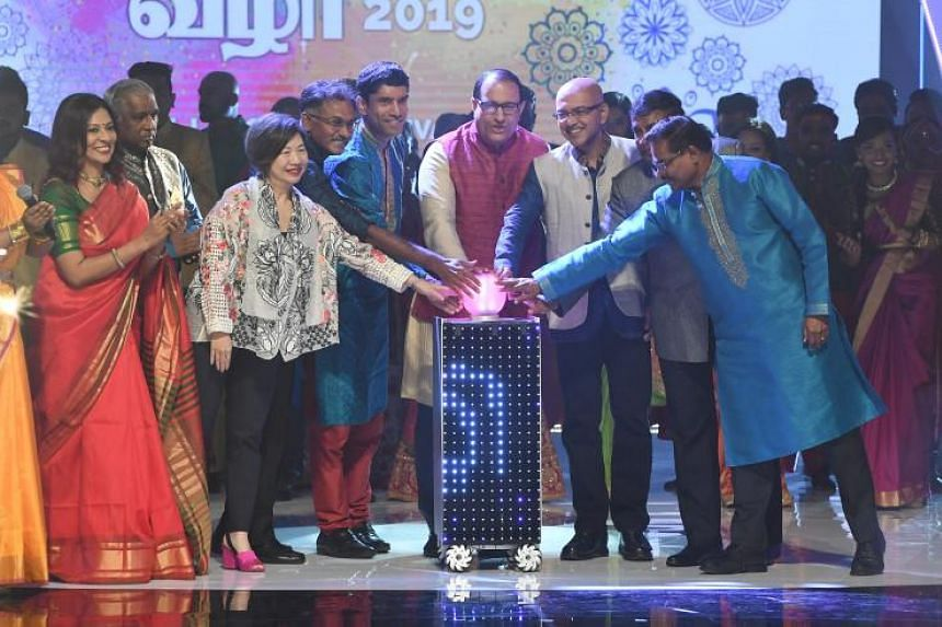 Communications and Information Minister S. Iswaran (centre, in red) at the launch of the annual Tamil Language Festival on March 24, 2019.