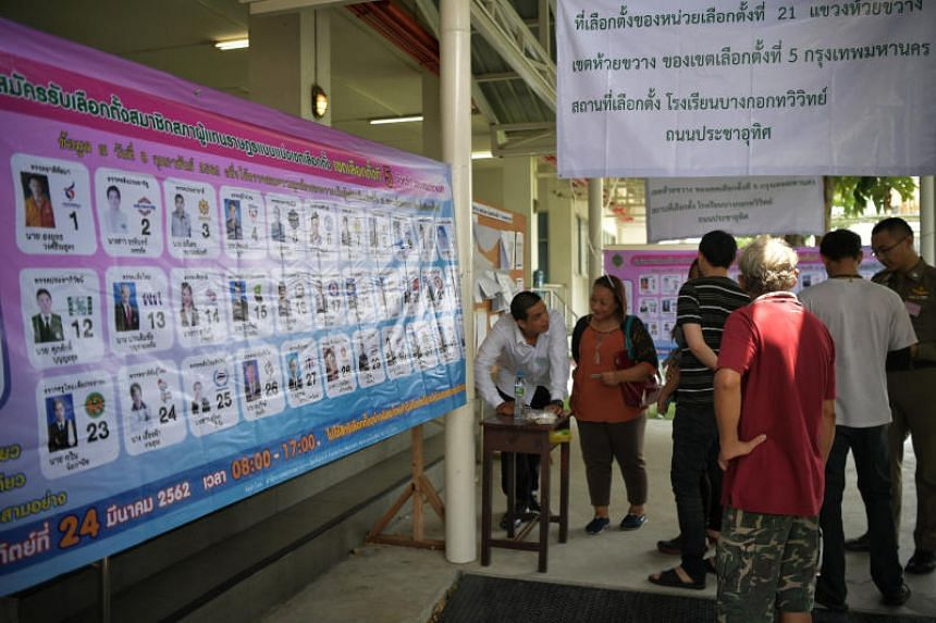 Voters waiting at a polling station at the Bangkok Thawiwit School, on March 24, 2019.