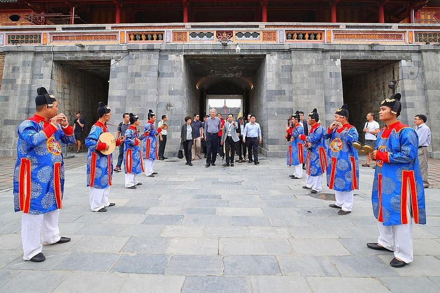 Deputy Prime Minister and Coordinating Minister for National Security Teo Chee Hean at the Hue Imperial Citadel Noon Gate during a visit to the city of Hue in Vietnam yesterday. He is on an official visit to Vietnam from last Thursday until tomorrow.
