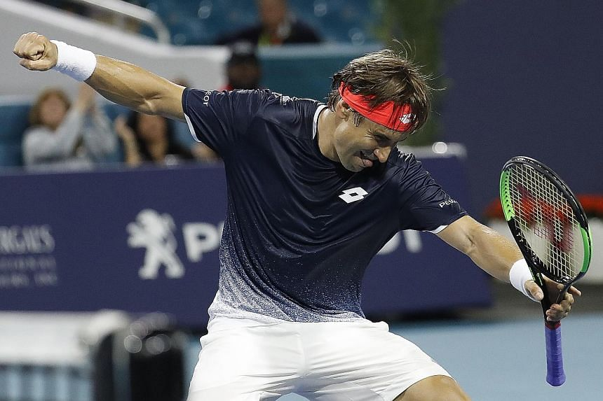 David Ferrer is ecstatic after taking a point against Alexander Zverev during their second-round match at the Miami Open. Ferrer won 2-6, 7-5, 6-3.