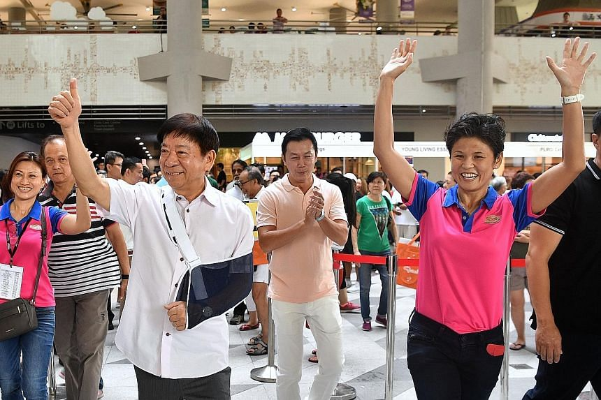 Transport Minister Khaw Boon Wan, Dr Lim Wee Kiak, a fellow MP for Sembawang GRC, and grassroots leader Poh Li San (right) arriving at the Women's Festival 2019 held at Kampung Admiralty yesterday. It was Mr Khaw's first appearance at a grassroots ev