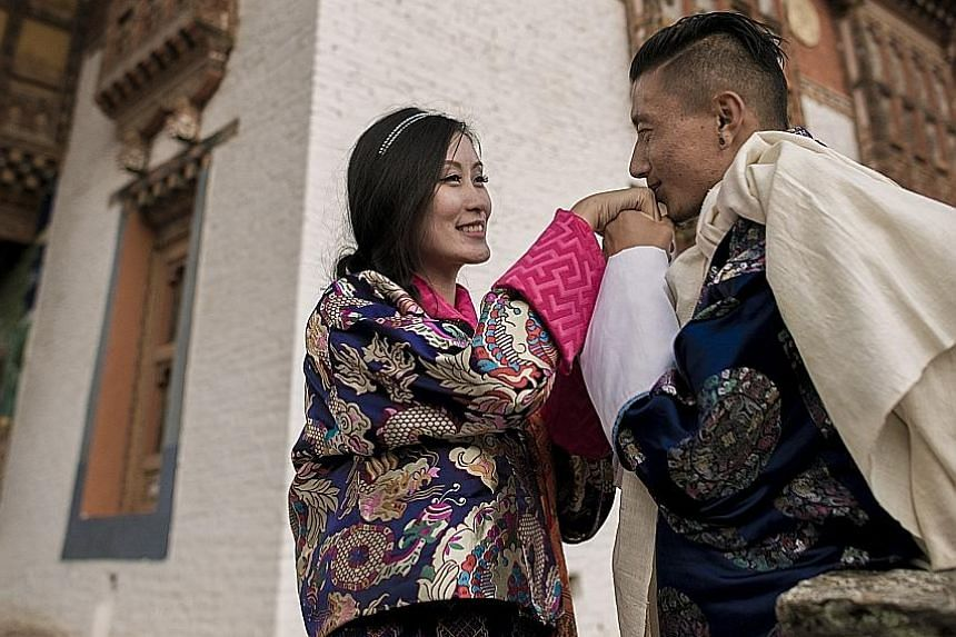 Singapore permanent resident Karen Lim met her Bhutanese husband Ngawang Tshering (both above) during a trip to the country and the couple married last year.