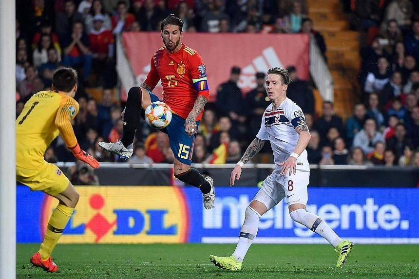 "Spain's defender Sergio Ramos challenging Norway goalkeeper Rune Jarstein and midfielder Stefan Johansen during their Euro 2020 qualifier at the Mestalla Stadium in Valencia. The Real Madrid man delivered the winner with a ""Panenka"" spot kick in the"