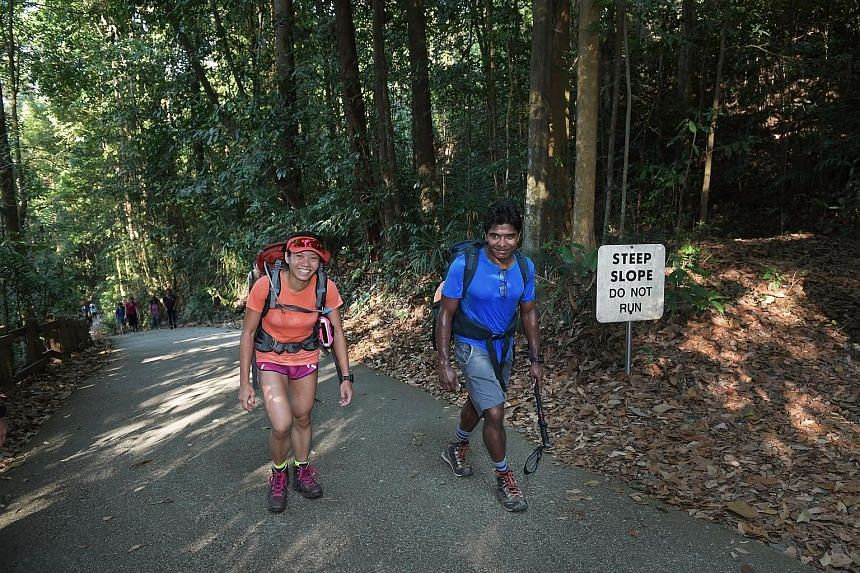 Mr Anandan Bala and Ms Sim Phei Sunn training at Bukit Timah Hill recently in preparation for their Mount Everest climb. They are due to be at the 5,400m Everest Base Camp next month and expect to reach the top in mid-May.