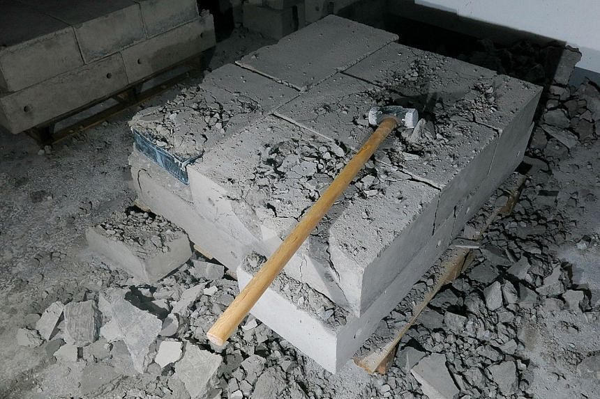 Smugglers have turned to more elaborate methods to conceal duty-unpaid cigarettes, including by hiding them in concrete slabs. The number of peddlers caught increased by 11 per cent to 343 last year.