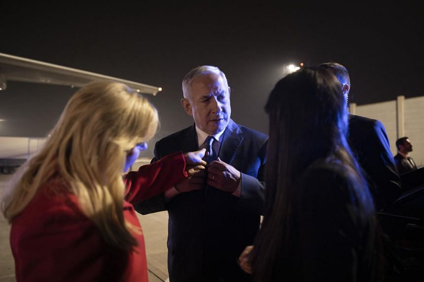 Israeli Prime Minister Benjamin Netanyahu (centre) before a flight to Washington from Tel Aviv, Israel on March 24, 2019.