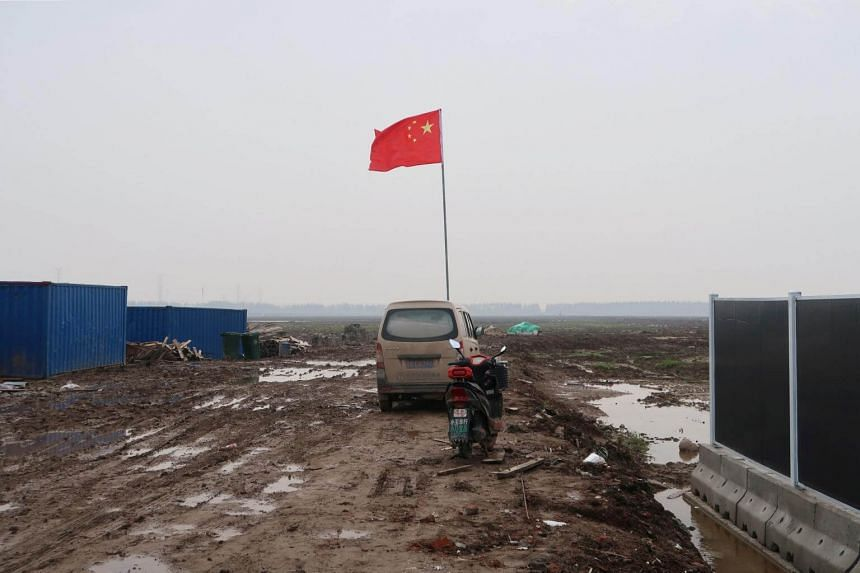 A Chinese flag is seen on the land secured by Tesla for its Gigafactory in Shanghai, China, on Dec 16, 2018.
