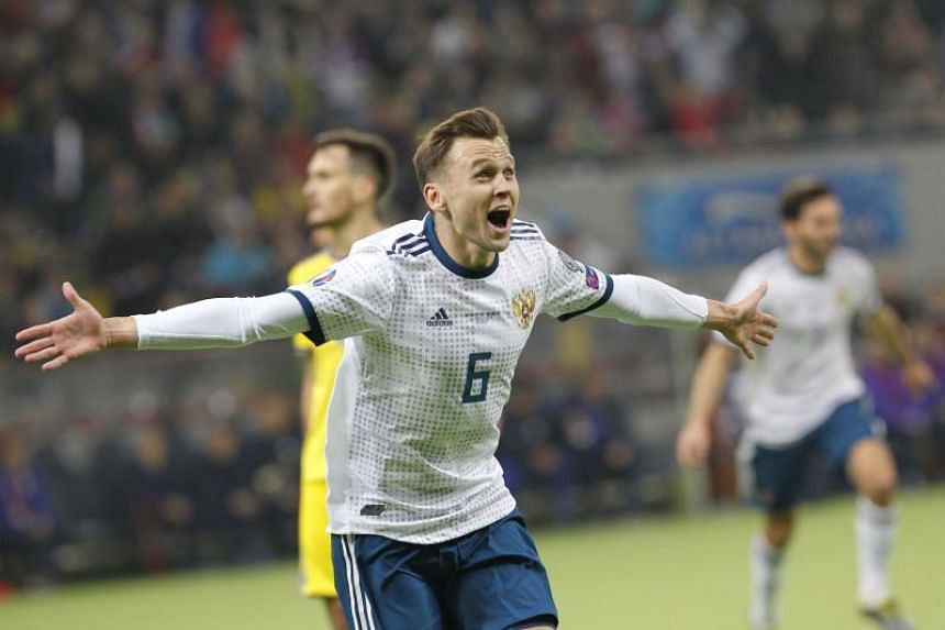 Russia's Denis Cheryshev (above) scored twice before half-time and laid on the third for captain Artem Dzyuba after the break while Kazakhstan's Abzal Beysebekov deflected a shot into his own net.