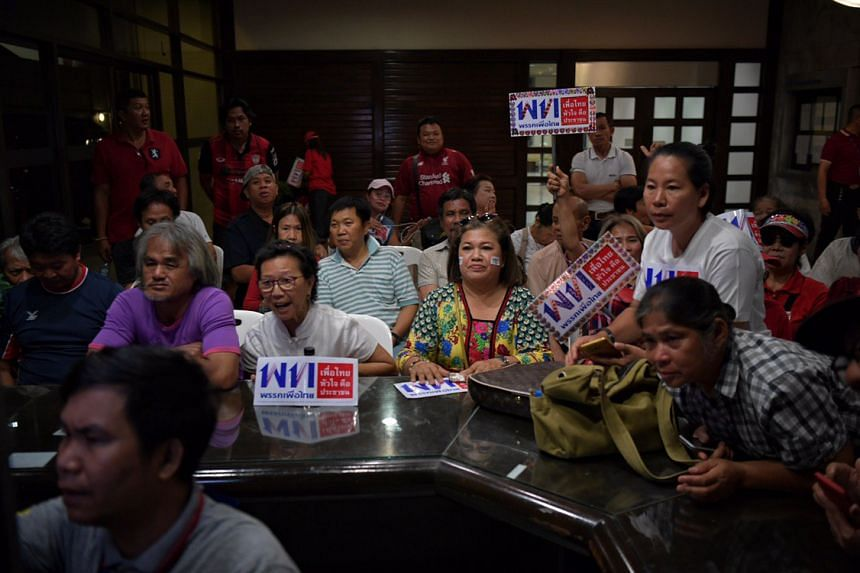 Pheu Thai party supporters following the election results at the party's headquarters in Bangkok on March 24, 2019.