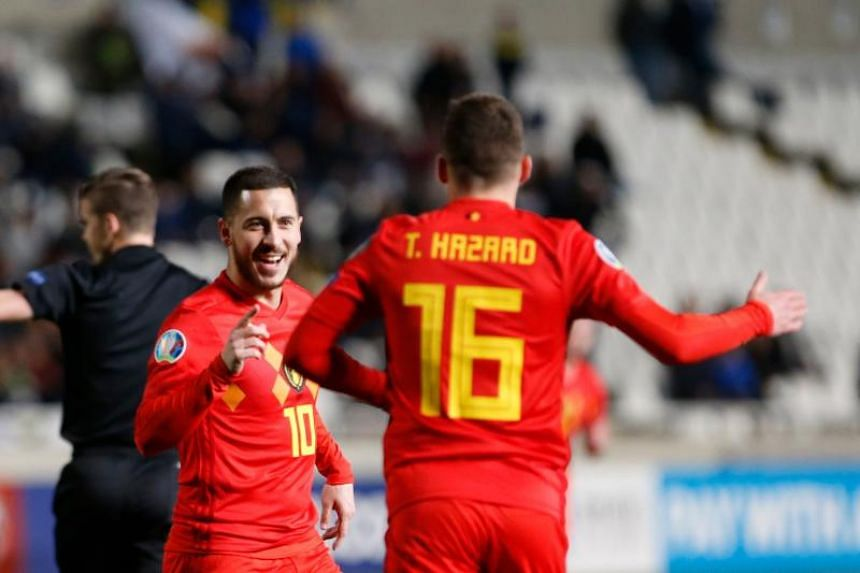 Belgium's Eden Hazard opened the scoring after 10 minutes with a curling shot after Michy Batshuayi had set him up.