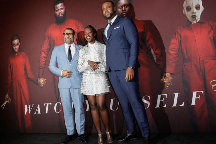 (From left) Us director Jordan Peele and actors Lupita Nyong'o and Winston Duke at the movie's premiere at The Museum of Modern Art in New York City on March 19, 2019.