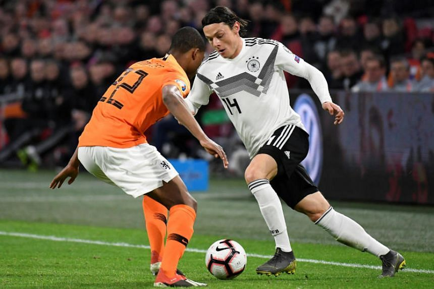 Germany's Nico Schulz scored in the 90th minute to fire Germany to a dramatic 3-2 victory over the Netherlands in their opening Euro 2020 qualifier in Amsterdam on March 24, 2019.