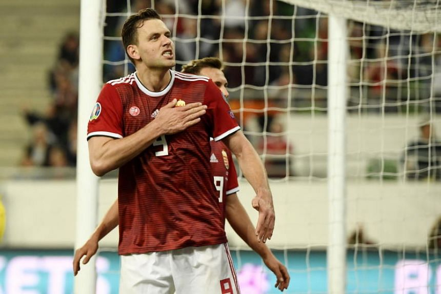 Hungary's Adam Szalai celebrates scoring their first goal during their Euro 2020 Group E qualifier match against Croatia in Budapest on March 24, 2019.