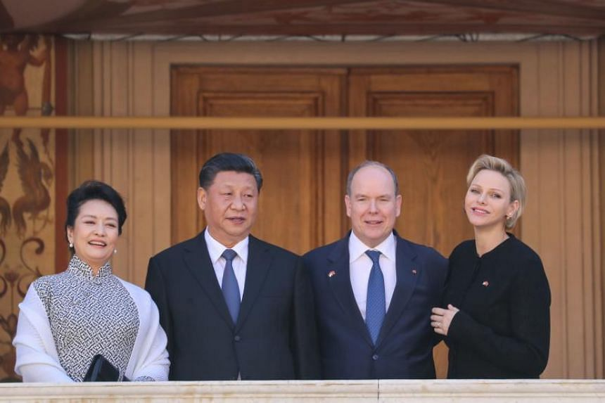 Monaco's Prince Albert II and Princess Charlene receive Chinese President Xi Jinping and his wife Peng Liyuan at the Monaco Palace on March 24, 2019.