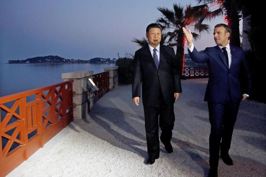 French President Emmanuel Macron and Chinese President Xi Jinping arrive for a dinner at the Villa Kerylos in Beaulieu-sur-Mer, near Nice, France, on March 24, 2019.