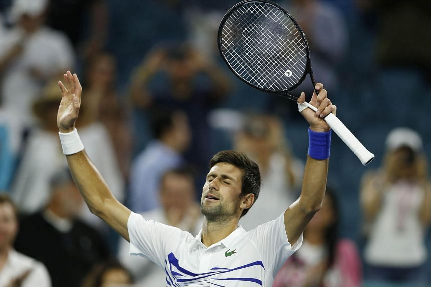 Novak Djokovic celebrates after defeating Federico Delbonis of Argentina on Day 7 of the Miami Open Presented by Itau at Hard Rock Stadium on March 24, 2019.