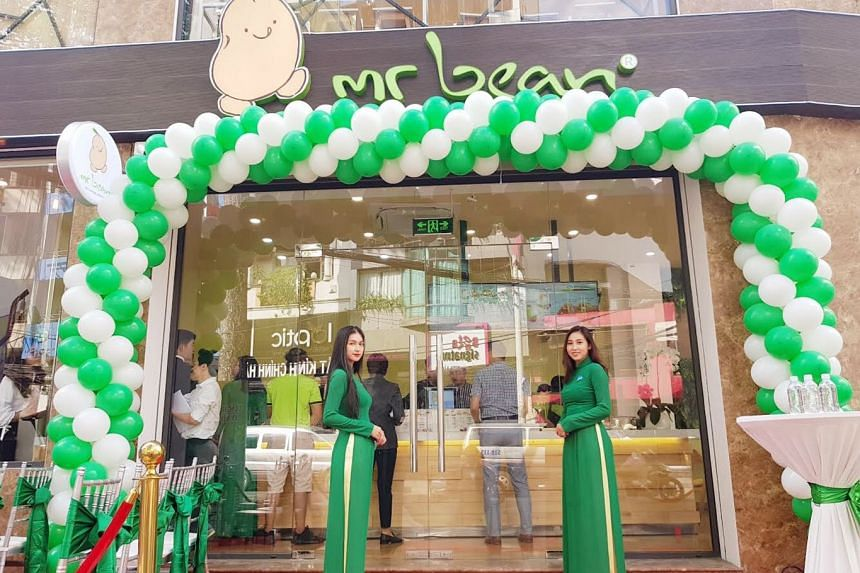 Staff welcoming customers at the official opening of the Mr Bean outlet in Vietnam.