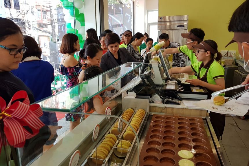 Customers at the official opening of the Mr Bean outlet in Vietnam.