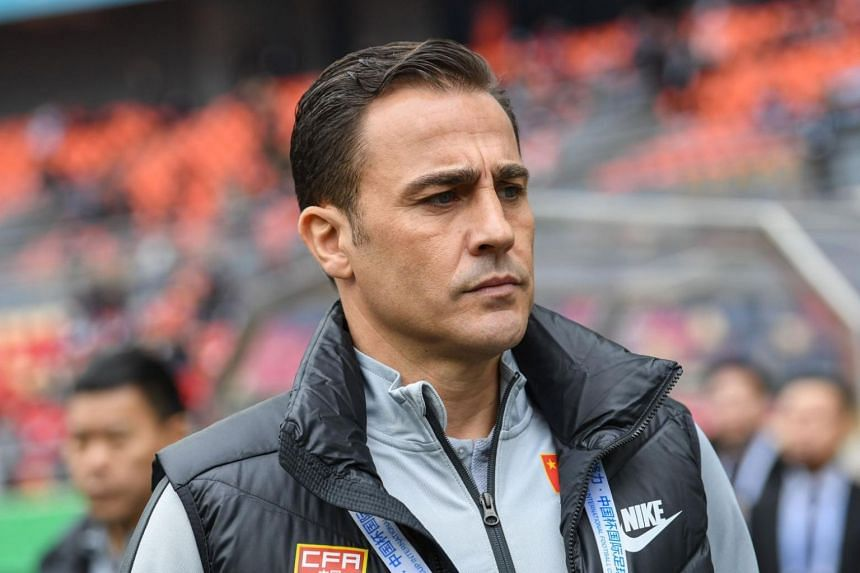 China's new head coach Fabio Cannavaro reacts during the 2019 China Cup third place play-off football match between China and Uzbekistan in Nanning in China's southern Guangxi region on March 25, 2019.