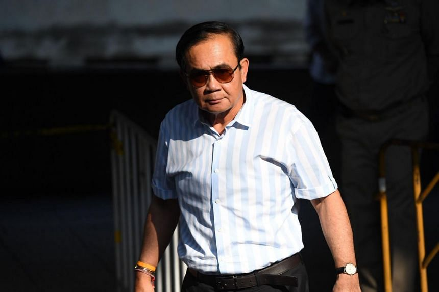 Thailand's Prime Minister Prayut Chan-o-cha leaving a polling station in Bangkok after casting his vote on March 24, 2019, in the country's first election since the 2014 coup.