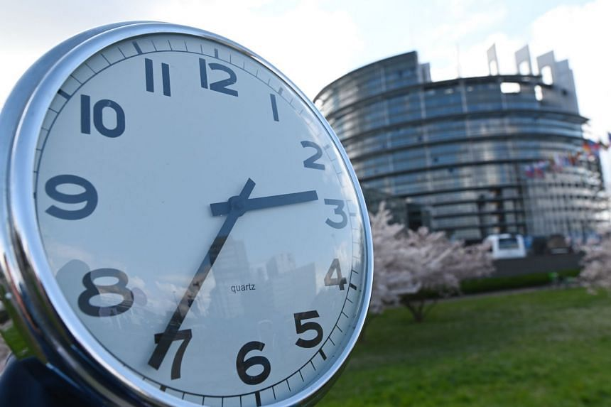 A clock is held next to the European Parliament in Strasbourg, France.