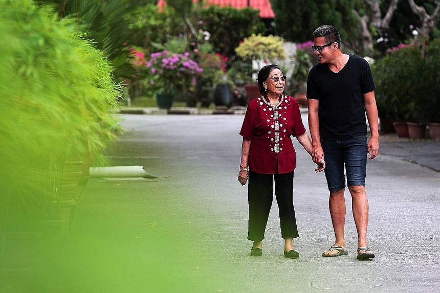 Breakthrough Missions long-time volunteer Khaw Seow Wah with former drug abuser Aaron Xie. She helped to reunite him with his family.