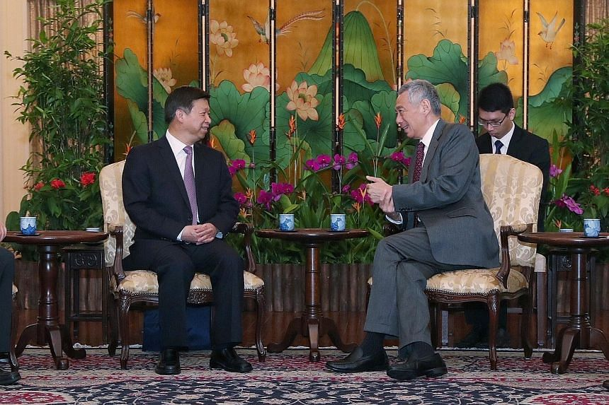 Chinese Communist Party's Minister of the International Department Song Tao with Prime Minister Lee Hsien Loong at the Istana yesterday. The two leaders discussed the deepening cooperation between China and Singapore in multifaceted areas, including