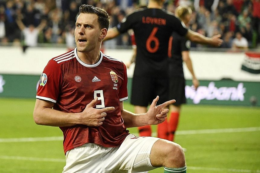 Adam Szalai celebrating after scoring the equaliser for Hungary, who went on to beat Croatia 2-1 in their Group E Euro 2020 qualifier in Budapest on Sunday.