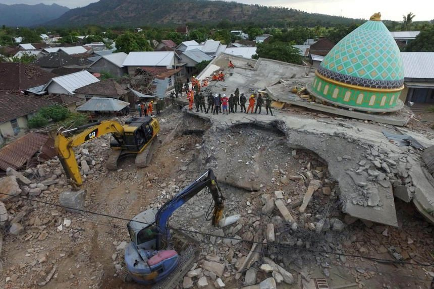 An aerial view of a collapsed mosque following an earthquake in Pemenang, North Lombok, on Aug 8, 2018.