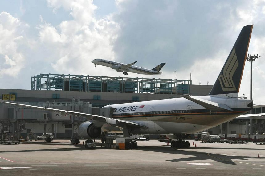 A Singapore Airlines plane at Changi Airport. SQ Flight 423 was escorted safely back to Changi Airport by Singapore's air force and touched down at about 8am.