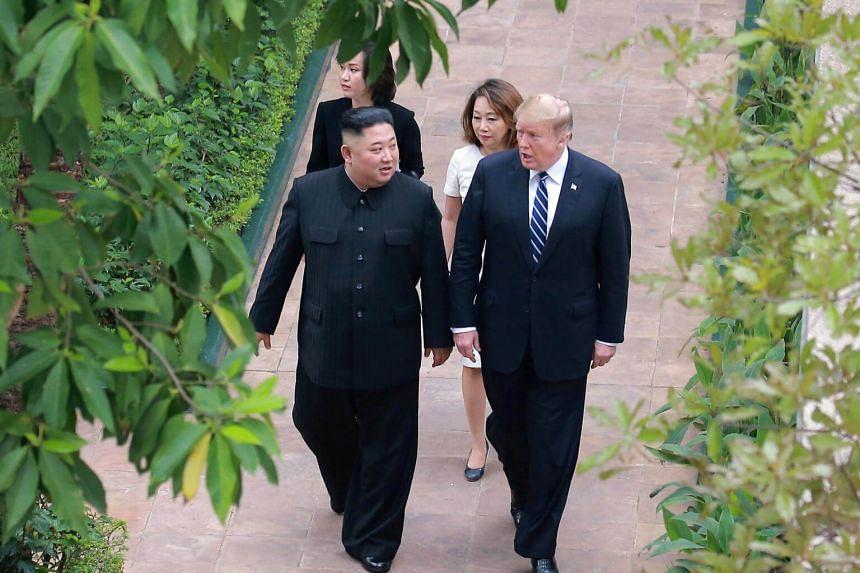North Korean leader Kim Jong Un (left) walks with US President Donald Trump during the second North Korea-US summit in Hanoi, Vietnam.