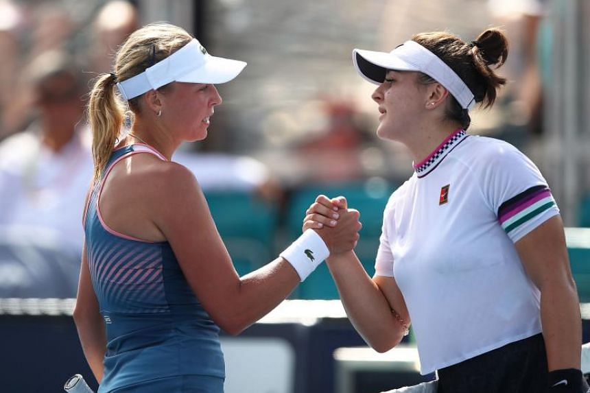 Bianca Andreescu of Canada (right) retires in her match as she shakes hands with Anett Kontaveit of Estonia during the Miami Open Tennis on March 25, 2019 in Miami Gardens, Florida.