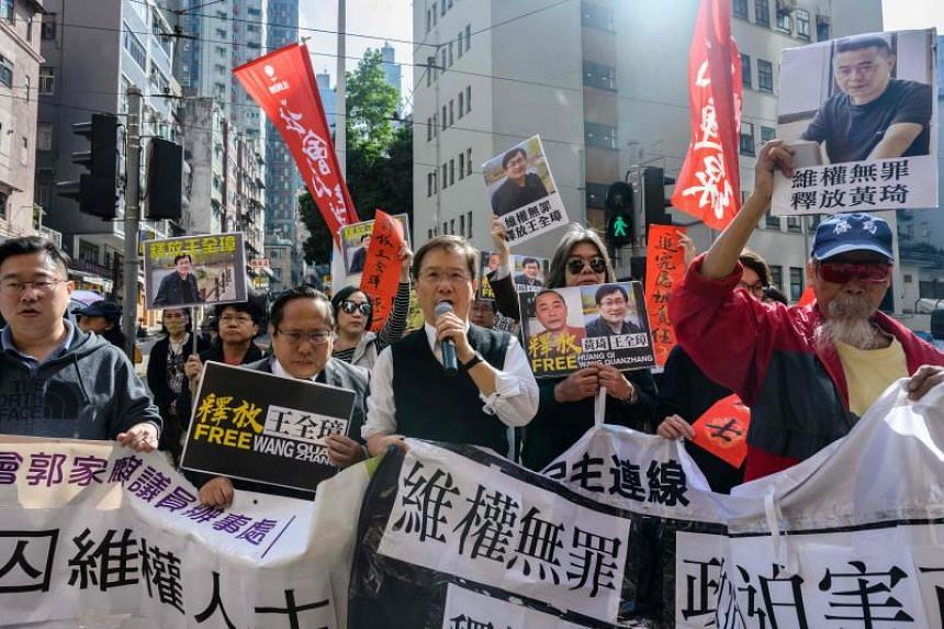 """Pro-democracy activists march during a protest in support of jailed Chinese human rights lawyer Wang Quanzhang and China's first """"cyber-dissident"""" Huang Qi in Hong Kong on Jan 29, 2019."""