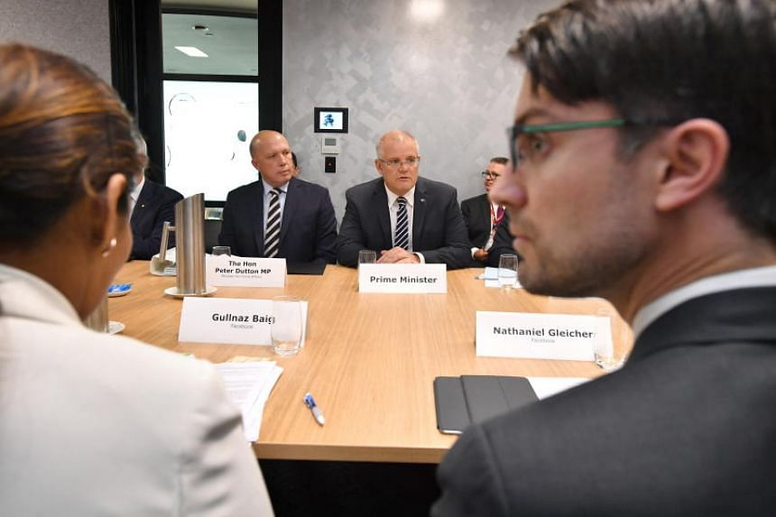 Australian Prime Minister Scott Morrison and Australian Minister for Home Affairs Peter Dutton meet social media executives at the Waterfront Place in Brisbane on March 26, 2019.