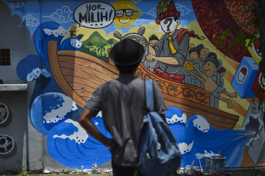 An Indonesian election campaign mural in Banda Aceh, Aceh province. With Indonesia's first-ever simultaneous presidential and legislative elections drawing closer, spending by the government and political parties is already in overdrive.