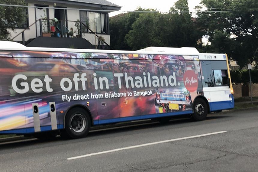 """The response comes after Twitter users posted photos of AirAsia ads on a bus and Brisbane airport reading, """"Get off in Thailand""""."""